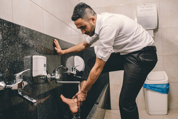 Muslim cleaning his legs before the prayer