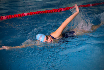 Young woman swimmer