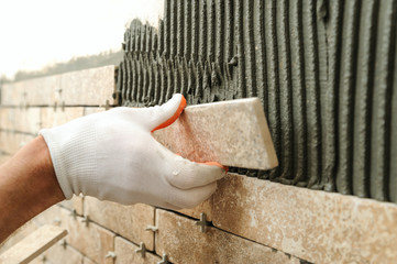 Installing the tiles on the wall.