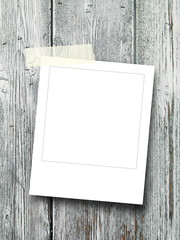 Blank square photo frame on gray wooden background