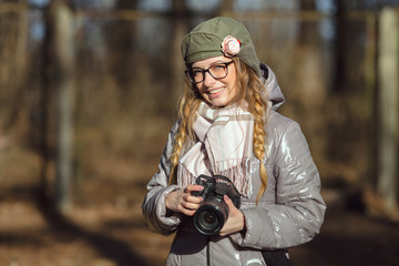 Young european woman photographer enjoying first spring sun exploring suburban locations