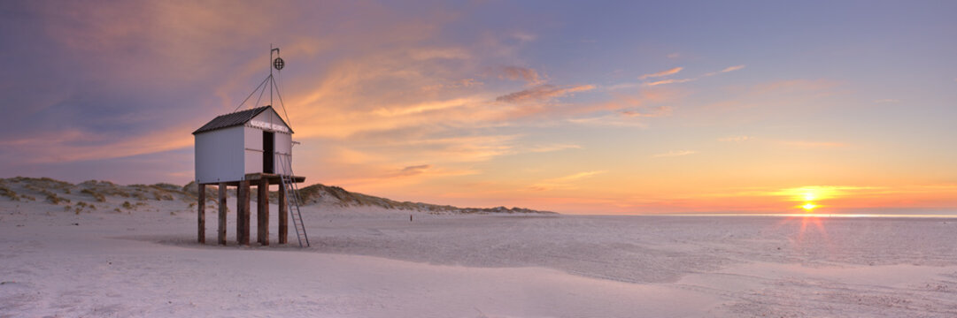 Refuge hut on Terschelling island in The Netherlands at sunset