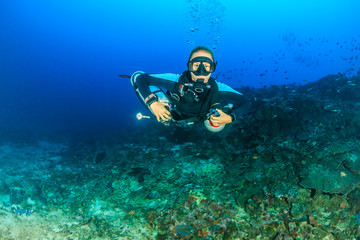Canvas Prints Diving Female SCUBA diver using a techical side mount system on a deep coral reef