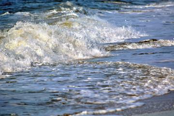 Waves Washing Up onto the Beach Along the Coastline