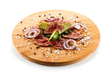 Carpaccio steaks on wooden board