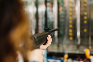 Woman aiming in shooting range