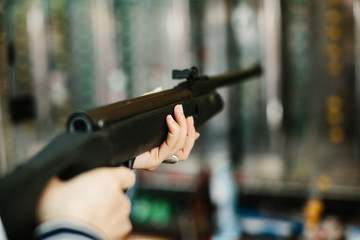 Woman aiming in shooting range