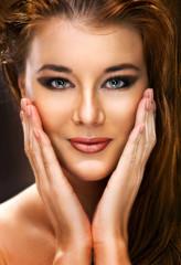 Portrait of a beautiful female model on dark background