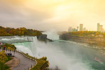 American side of Niagara Falls during sunrise .