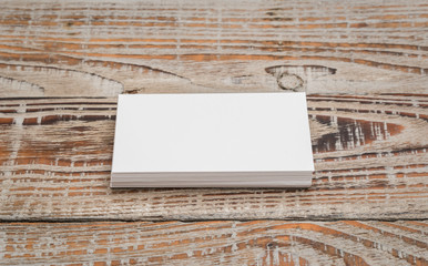 Business cards on wood table .