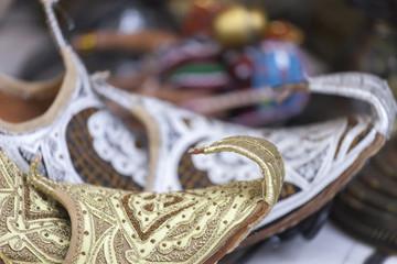 Vintage arabic slippers at the market in Dubai, UAE