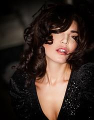 Gorgeous and elegant woman portrait wearing black sequin dress