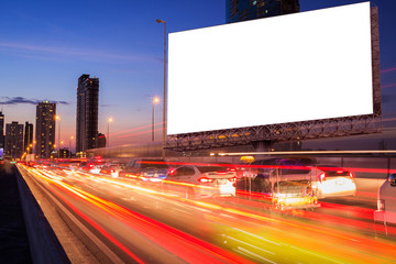 light trails, street and urban in the night with blank billboard- can advertisement for display business