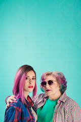 portrait of retired woman and girl with pink hair