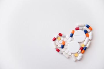 pills heart on white background