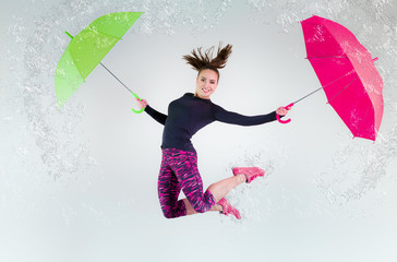 Woman in jump with an umbrella. Frozen motion.