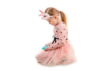 Girl dressed for easter holding eggs, isolated