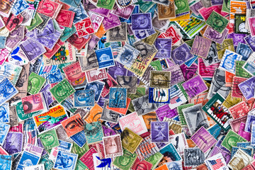 A Collection of used US Postage Stamps off paper