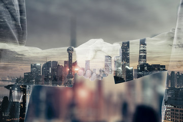Successful handshaking after good deal. Business partnership meeting concept. Double exposure image