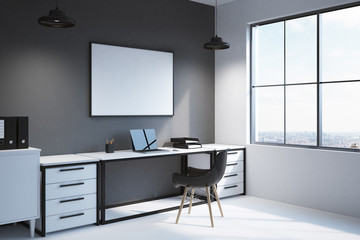 Corner of modern workspace with computer