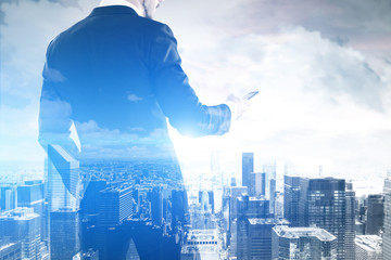 Double exposure of a businessman and city