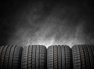 Car tires on a dark background.