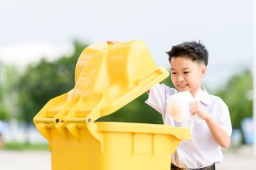 Boy trow the garbage