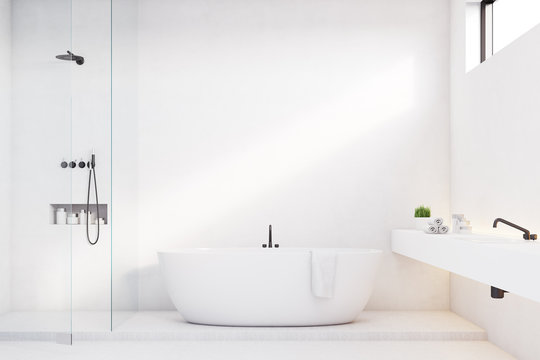 Luxury bathroom with white walls and shower