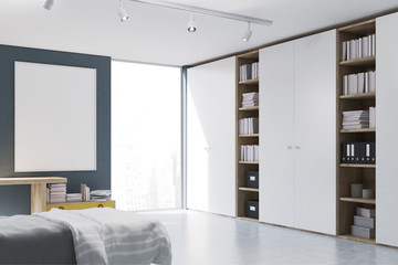 Gray walled bedroom with bookcase