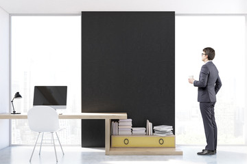 Man at stylish workplace with computer, front view