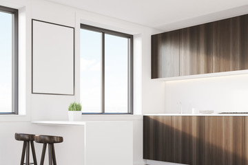 Dark wood kitchen corner with a table