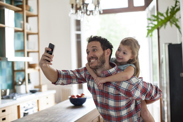 Father and daughter posing for selfie