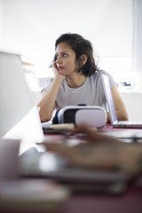 Woman looking bored at work