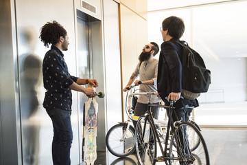 Men waiting for elevator