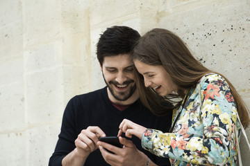 Couple using smartphone together