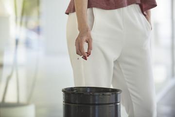 Woman on a cigarette break, cropped