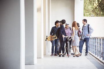 Group of college students chatting together after class