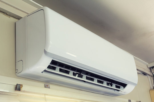Air conditioner (AC) indoor unit or evaporator and wall mounted. That is part of mini split system or ductless system type. For removing heat and moisture from room. Including humidity control.
