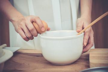 pregnant woman prepares a meal