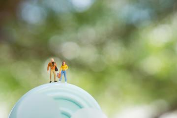 Miniature people couple on turbine
