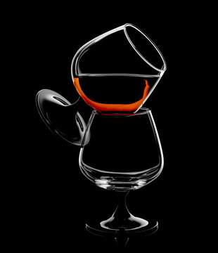 Silhouette of brandy snifter glass isolated on black background.