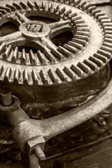 part of old industrial mechanism. large rusty gearwheel.
