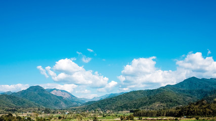Town in north of Thailand. Mountain and blue sky landscape photo