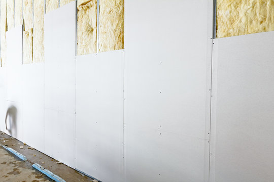 Front view of gypsum wall, plasterboard is under construction