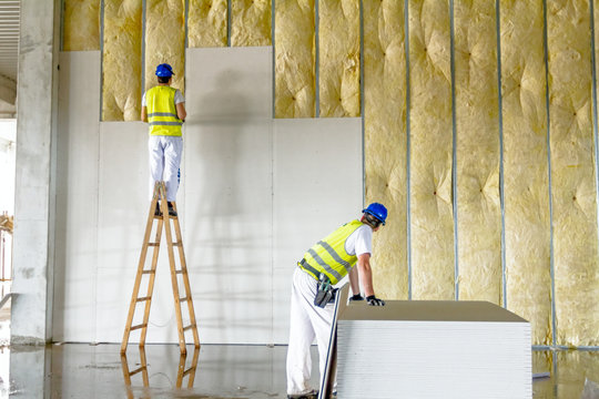 Riggers are working on thermal partition dry wall with mineral wool