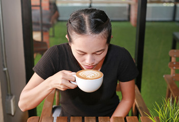 Woman drinking hot coffee in the morning.