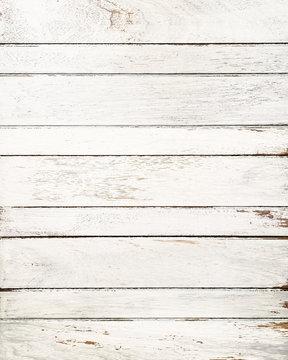 Vintage white wood background with peeling paint.