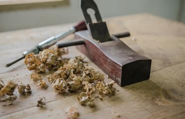 The carpenter was working furniture wood in studio , Soft-focus image