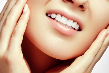 Woman teeth after whitening. Happy smiling woman. Dental health concept. Oral care. Beautiful white teeth. Stomatology concept. Beautiful model girl with clean skin