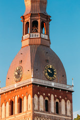Clock On Tower Of Riga Dome Cathedral In Riga, Latvia. Sunny
